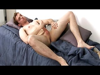 Young latin man masturbates his package