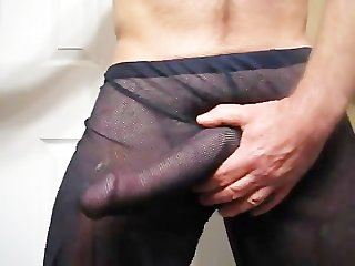Thick dick grows and cums through mesh pants
