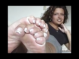 Raven shows off her long french pedicure nails and sexy soles