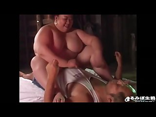 Asian fat woman is torturing a guy