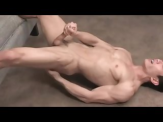 Fit asian hunk screams out as he shoots load