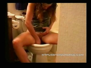 Teen masturbating with tampon at the Toilet