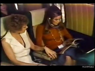 Retro lesbian girl on airplane lick a passenger pussy without permission
