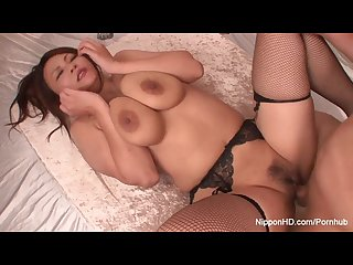 Busty asian hottie in fishnets gets fucked hard