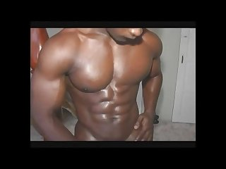 Muscled African hunk jerks off cums