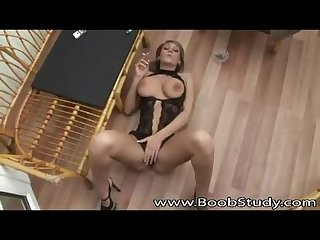 Busty smoking fetish blonde in lingerie high heels