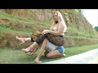 Heavy woman riding a strong young girl