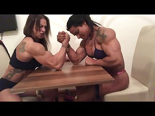 Female bodybuilder armwrestling