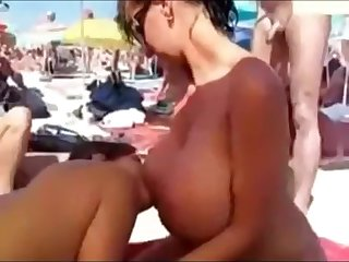 Shameless pubic orgy at nude beach
