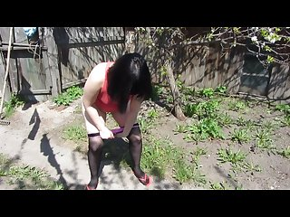 I piss in nylon pantyhose in a rustic garden
