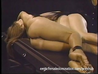 Mistress tortures two girls at the same time