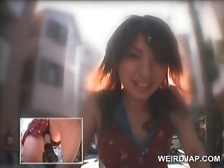 Superb japanese cutie masturbates with dildo on her bike