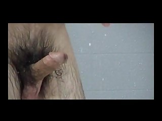 Hairy jock in open Showers