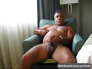 Mature and tanned real daddy tugging his cock on webcam