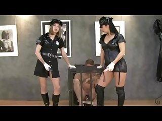 Sexy mistress in police uniform fucks and domina guy