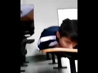 Asian teen jerks in public school