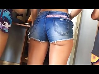 Very sensual teen shows her big ass in mini short