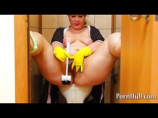 Fat girl with hairy by a pussy masturbating in the toilet