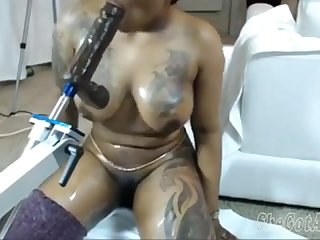 Sexy black girl with fucking machine on webcam