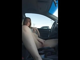 Hot blonde masturbates in car