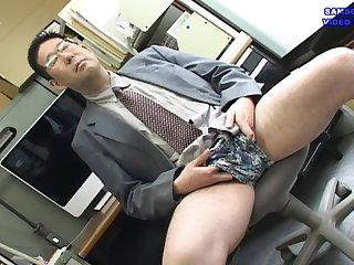 A salaryman with trunks masturbating