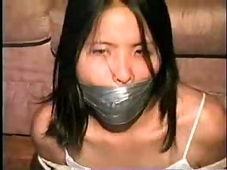 Asian girl wrap gagged and bound very hot