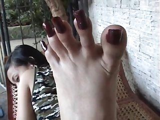 Asian toe spread long toenails