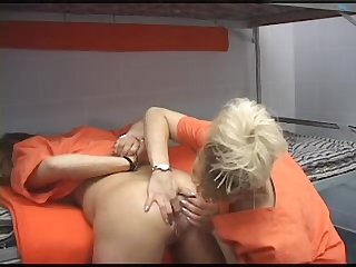 Handcuffed girl fucked by her cellmate