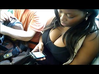 Huge black Juggs cleavage in the bus