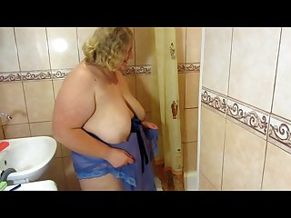 Fat milf with big tits pissing standing