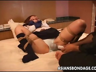 Asian school girl gets tied up for a bdsm surprise