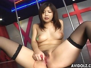 Asian Dancer masturbates on stage