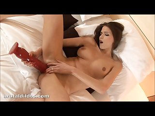 Sexy skinny chick stretching her tight pussy with a huge red dildo in hd