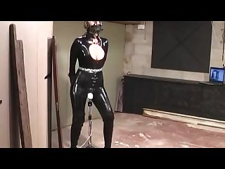 Latex slut in bondage