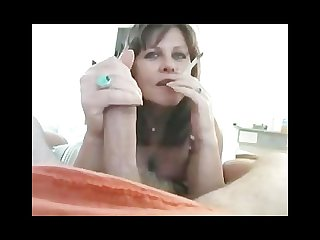 Hot mature strips and jerks while smoking