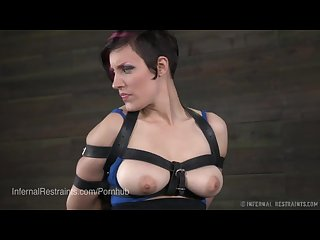 Naturally busty babe bound and whipped in leather straps