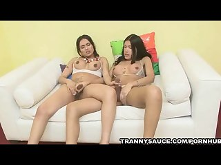 Two hot shemale babes sharing a studs hard cock