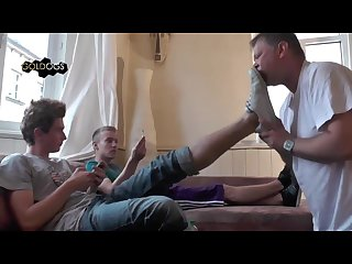 Two hot straight boys chill on the couch while their fag slave serves them