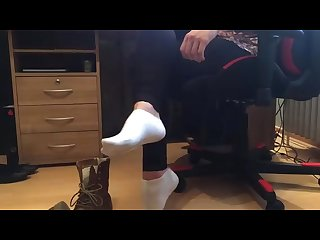 Pretty teen girl wearing boots and white socks