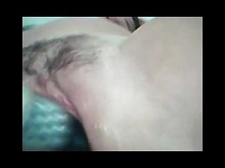 Playing with a toy in her very wet pussy