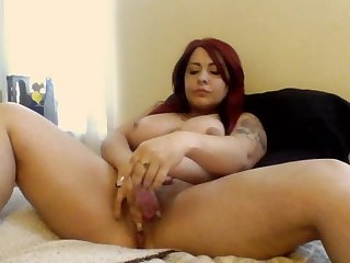 Sexy tattooed milf maturbates cums hard