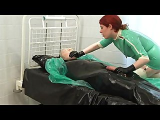 Latex tied smothered slave gets handjob