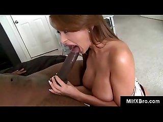 Busty redhead milf sucks big black pipe