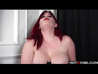 Curvy redhead in corset toys her pussy