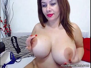 Busty milf masturbates on webcam