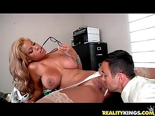 Bridgette B bares her juggs and sucks on voodoo s big cock