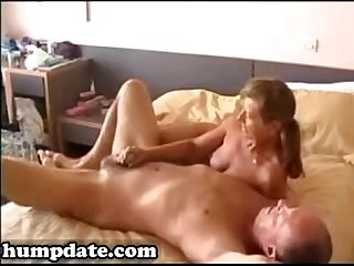 Naked wife gives hubby great handjob
