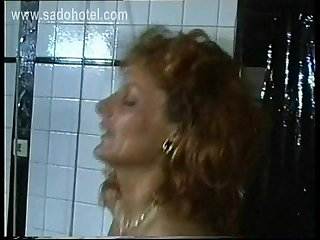 Masked master put large metal clamps on milf slave her pussy and hits her with a whip