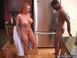 A sexy blonde milf is sucking a big black cock