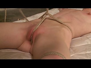 Tied up sub gagged and suspended by her master